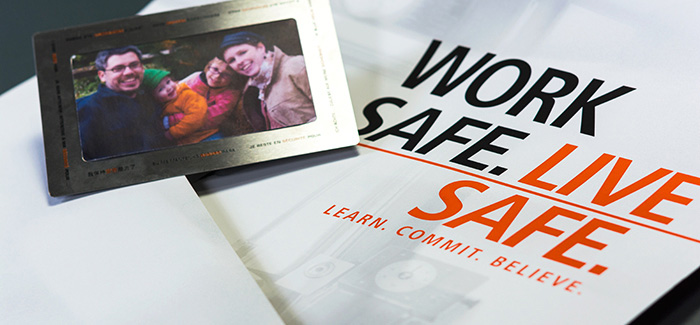 ADM Safety photo frame sitting on top of brochure